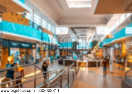 Shopping Center People Blurred Background. People Shopping In Modern Commercial Mall Center. Interio