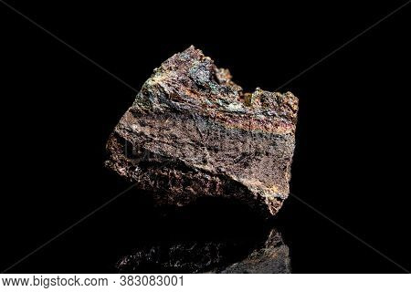 Limonite Or Brown Iron Ore, Raw Rock On Black Background, Mining And Geology, Mineralogy