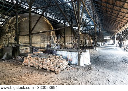 Kuala Sepetang, Malaysia, August 31St 2020: Traditional Charcoal  Factory With Big Kins That Bakes M