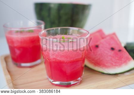Red Smoothie Watermelon In A Glass And Melon Cut Into Pieces, Placed On The Table Giving A Fresh, Sw