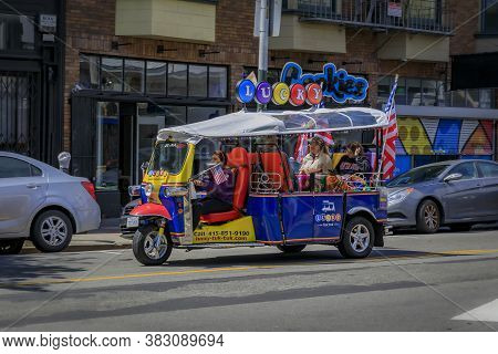 San Francisco, Usa - July 04, 2019: Tourist Tuk-tuk In The Eclectic Hippie Haight Ashbury Neighborho