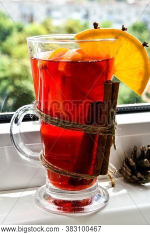 Christmas Mulled Wine With And Orange On Windowsill. Selective Focus. Anise Stars And Cinnamon Stick
