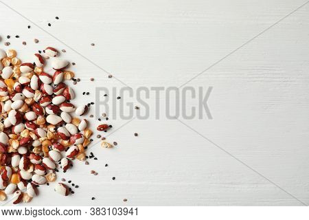 Mixed Vegetable Seeds On White Wooden Background, Flat Lay. Space For Text