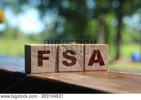 Flexible Spending Account Fsa Written On A Wooden Cubes. Financial Concept