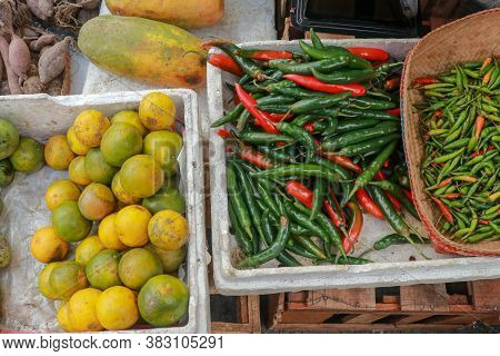 Red Chili Peppers On The Market. Pile Of Green Chilli Pepper On Display For Sale In The Pudu Wet Mar