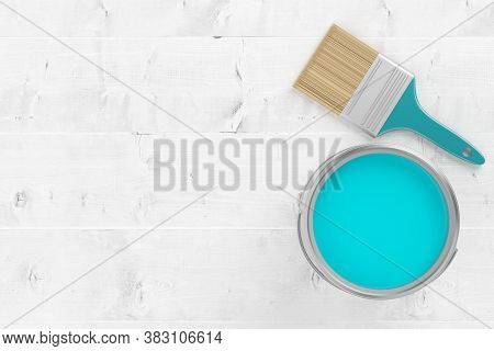 Paintbrush With Silver Paint Bucket With Cyan Paint On White Wooden Floor Background, Home Renovatio