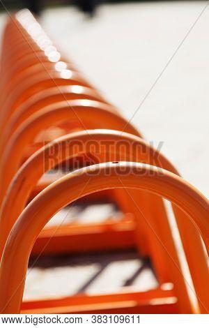 Many Orange Bike Racks Near The Skelleftea River