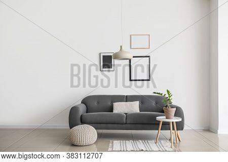 Sofa Near Wall In Interior Of Living Room