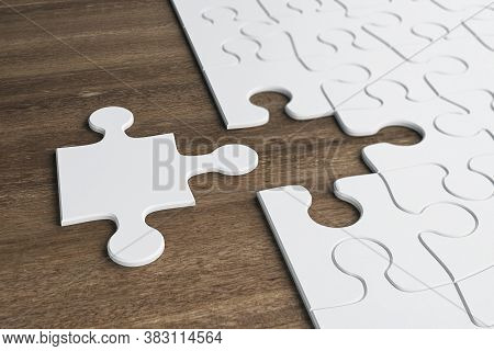 Incomplete White Puzzles On Wooden Table. Business And Teamwork Concept. 3d Rendering