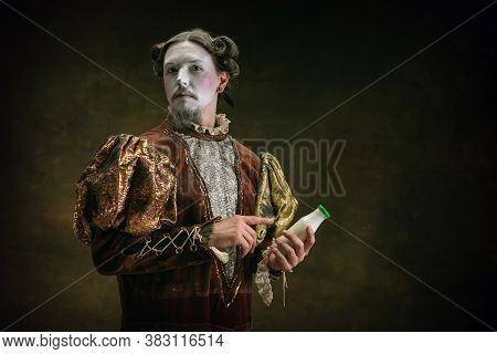 Drinks Milk. Young Man As Johann Bach Isolated On Dark Green Background. Retro Style, Comparison Of