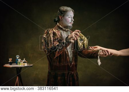 Disinfecting Hands. Young Man As Johann Bach Isolated On Dark Green Background. Retro Style, Compari