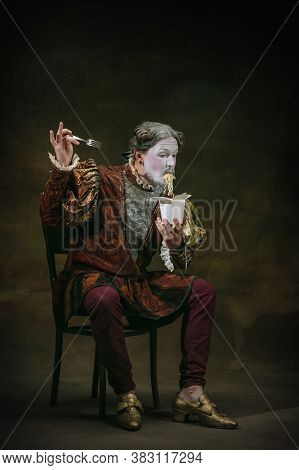 Eating Instant Noodles. Young Man As Johann Bach Isolated On Dark Green Background. Retro Style, Com