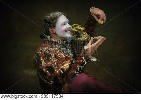 Eating An Oyster. Young Man As Johann Bach Isolated On Dark Green Background. Retro Style, Compariso