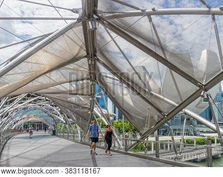 Singapore - January 24, 2016: Helix Bridge Is A Pedestrian Bridge Linking Marina Centre With Marina