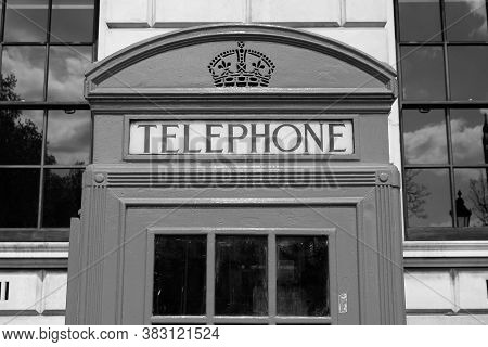 London, Uk - Telephone Booth Typical For England. Black And White Vintage Style.