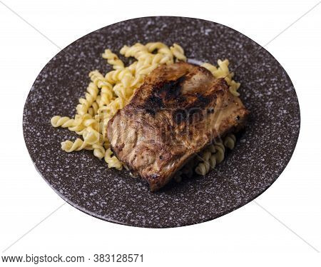Grilled Pork Ribs With Pasta. Grilled Pork Ribs On Brown Plate Isolated On White Background. Grilled