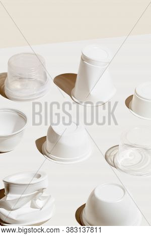 Creative Composition Of Plastic Waste Cup On White Background. Concept Of Environmental Pollution
