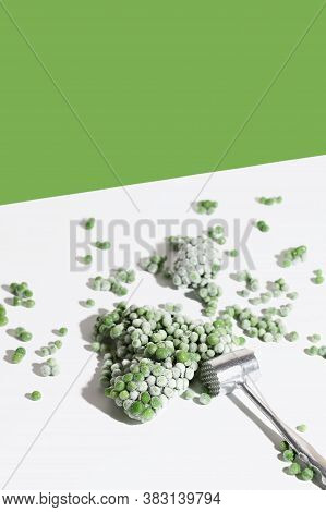 Modern Food Still Life Composition With Frozen Green Pea Vegetable. Concept Of Healthy Eating