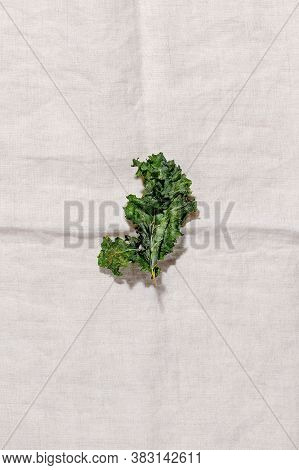 Veggie Kale Chips With Pepper And Olive Oil On Textile Napkin Top View.low-carb And Gluten Free Vege