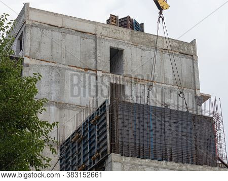 Construction Of A Wall Of A Multi-storey Building Using The Sliding Formwork Method. The Crane Holds