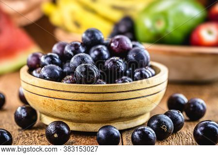 Jaboticaba Or Jabuticaba, Brazilian And South American Fruit, In A Rustic Wooden Basket.