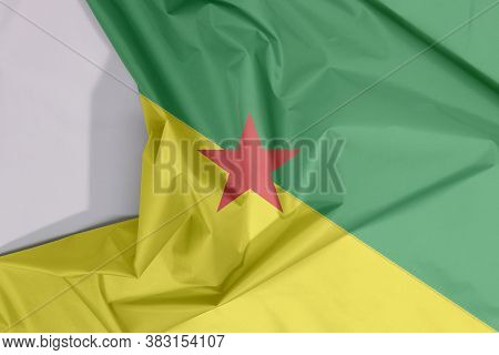 French Guiana Fabric Flag Crepe And Crease With White Space, The Green And Yellow With Red Star.