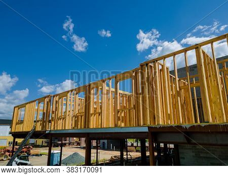 Wood Building Frame Structure On A New Development Framing Of A New House Under Construction
