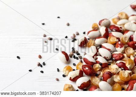 Mixed Vegetable Seeds On White Wooden Background, Closeup