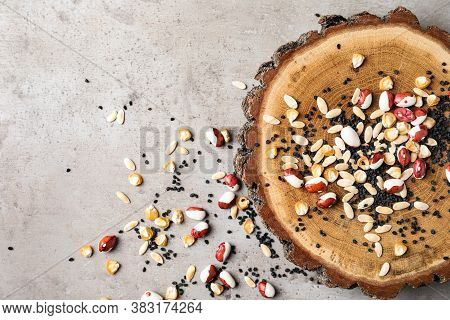 Mixed Vegetable Seeds And Wooden Log On Grey Background, Flat Lay