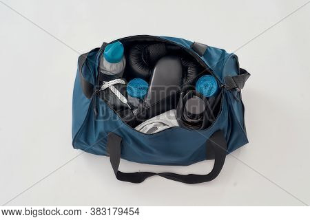 Boxing Gear For Training. Top View Of A Sports Bag With Boxing Gloves, Hand Wraps, Sport Clothes, Bo