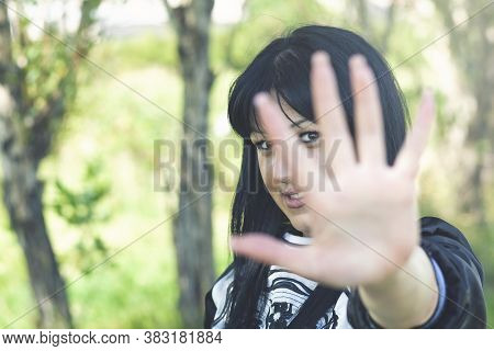 Woman With His Hands Shows Stop In The Nature