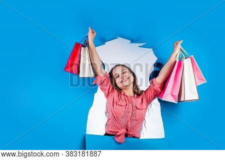 Feel The Success. Cheerful Girl After Successful Shopping. Kid Holding Many Shopping Bags. Prepare F