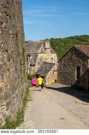 Beynac Et Cazenac, France - September 4, 2018: Tourists In The Cobbled Streets Of Beynac Et Cazenac
