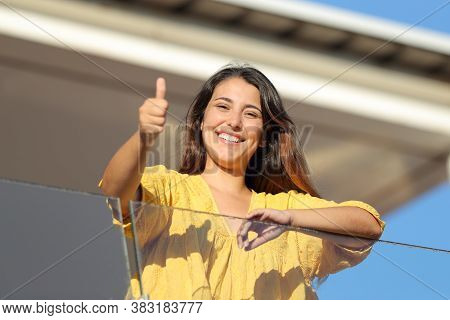 Happy Apartment Renter With Thums Up Looks At You In A Balcony A Sunny Day