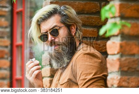 Smoking Outdoors. Smoking Habit. Fashionable Mature Man With Cigarette. Brutal Guy Sunglasses Smokin