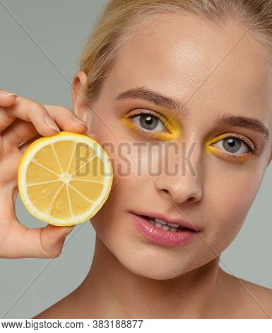 Great Food For A Healthy Lifestyle. Beautiful Young Shirtless Woman Holding Piece Of Orange In Front