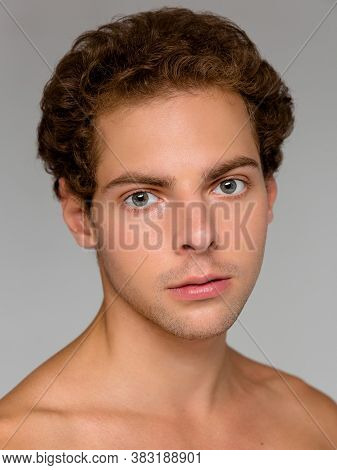 Portrait Of Handsome Positive Young And Fit Man Isolated On Gray Background