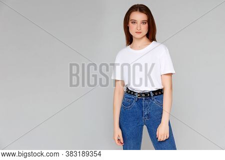 Sexy Woman In A White T-shirt On A Gray Background. Mock-up.