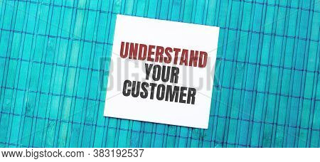 Blank Note Pad With Text Understand Your Customer On Blue Wooden Background