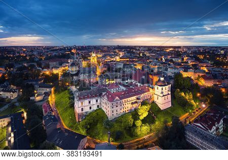 Lublin, Poland. Aerial View Of Old Town At Dusk With Historic Dominican Abbey On Foreground