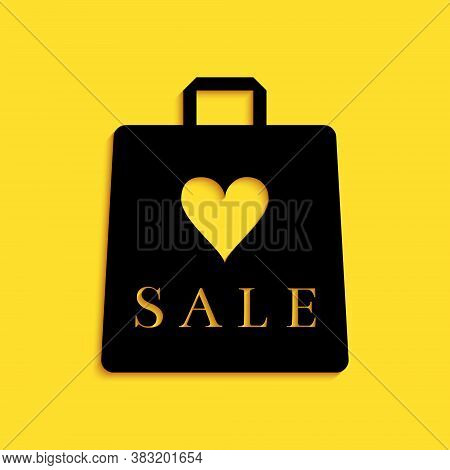 Black Shoping Bag With An Inscription Sale Icon Isolated On Yellow Background. Handbag Sign. Woman B