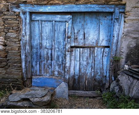 Old Blue Wooden Door In A Stone Wall, Rural Scene In The Village Of Paderne Do Courel In Lugo, Galic