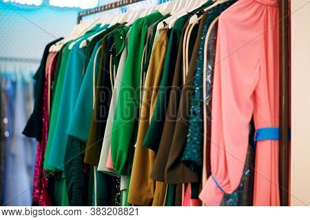 Women's Dresses On A Hanger, Multi-colored Dresses On The Trading Floor, Fashion Clothes, Bright Wom