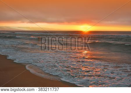 Beautiful Nature Background.Amazing Colorful Clouds.Water Reflections.Magic Artistic Wallpaper.Creative Photography.Orange Sky.Ocean Landscape.Tranquil Panorama.Yellow Color.Summer Sunset Sea Landscape.Relaxation,waves.Travel,sun.Ocean Sunrise.