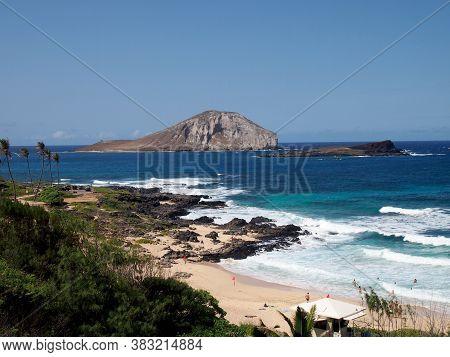 Waves Crash On Makapuu Beach With Rabbit And Rock Islands In The Distance Looking Towards Waimanalo
