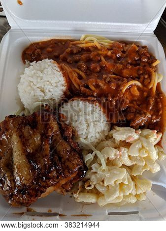 Mixed Plate:  Boneless Teri Chicken And Spaghetti With Rice And Mac Salad.