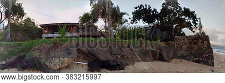 Honolulu - October 15, 2017: Panoramic Of Sand Bags And Seawall Attempting To Protecting Luxury Home