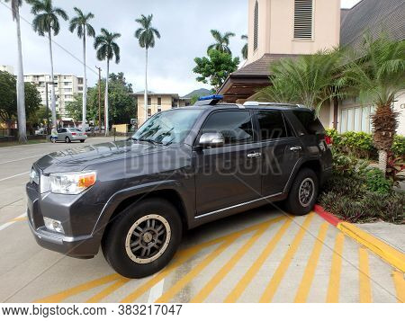 Honolulu - August 9, 2014:  Honolulu Police Department Police Suv Parked Outside Polling Booth On Oa