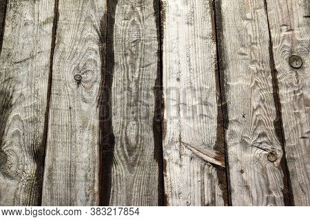 Photo Of A Wooden Background Made Of Wet Brown Boards