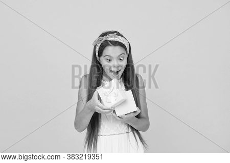 Omg. Surprised Child Open Box Yellow Background. Little Girl Got Surprise Gift. Birthday Surprise. S
